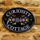 Curiosity Cottage plaque
