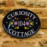 Curiosity Cottage plaque